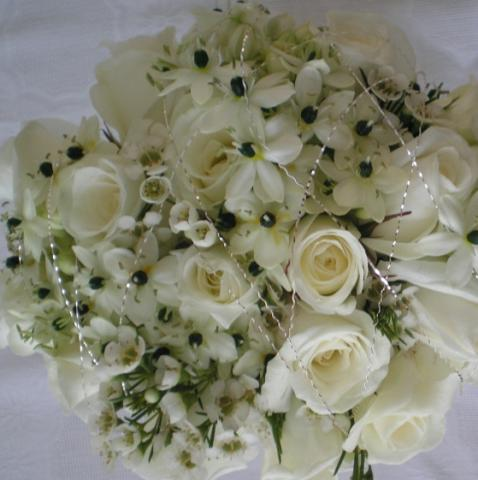 Brompton Floral Designs Wedding Flowers Central London UK NW4 Hand Tied Bunch of white Sweet Peas, Alchemilla, White Bouvardia, and Akito roses